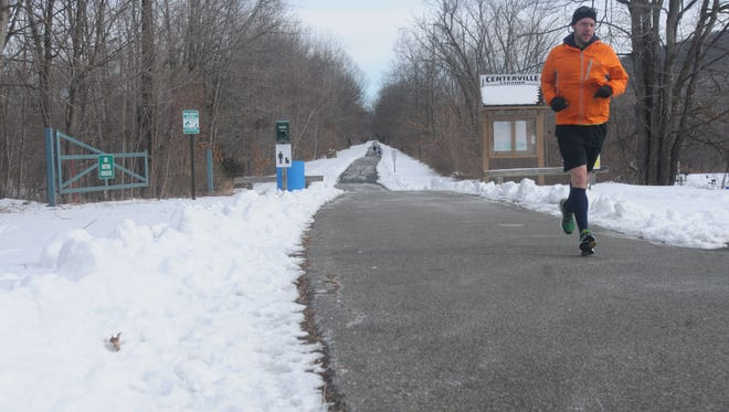 Hopewell Junction resident Bob Mackenzie, 36, jogs toward the end of the Hudson Valley Rail Trail in Highland on Thursday, Jan. 29, 2013. Plans are underway to extend the rail trail more than four miles west toward New Paltz, with the hopes of eventually providing a link to the Wallkill Valley Rail Trail.