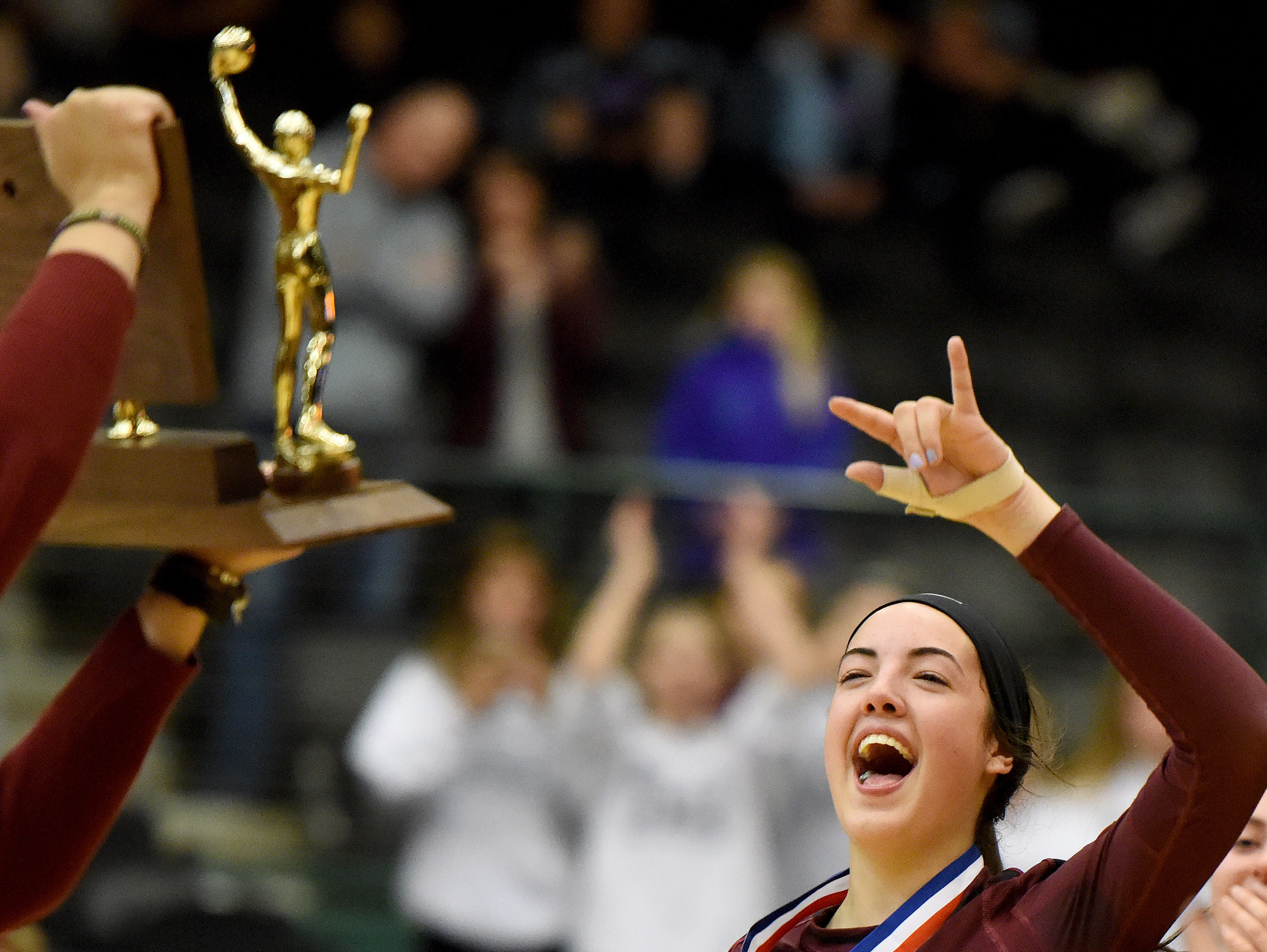 Harrisburg Samantha Slaughter rejoices after defeating Roosevelt to win the S.D. State AA Volleyball championship at the Swiftel Center in Brookings.