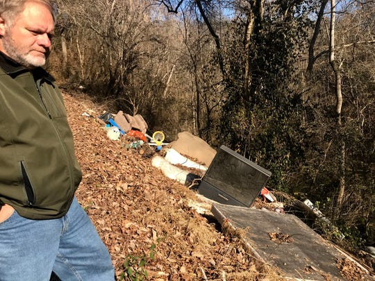 Knox County Commissioner Carson Dailey stands next to a garbage dump along Twin Creek Road in South Knoxville. Dailey is petitioning lawmakers to amend a new law that restricts Knox County's ability to have a litter crew pick up trash.
