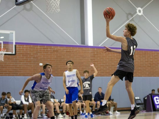 Arcadia basketball player Max Majerle,  goes up for