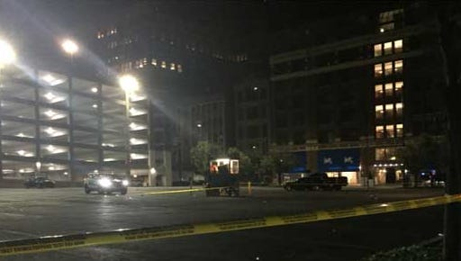 A man was found shot multiple times in a parking lot Downtown early Monday.
