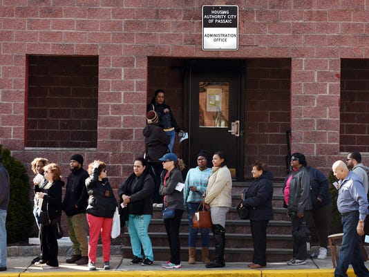 Thousands line up for a shot at Passaic housing funds