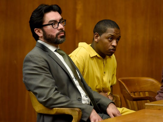 Attorney Jose Torres with his client Nyje Johnson in court Monday for a pretrial hearing in the 2014 killing of 14-year-old Nazerah Bugg of Paterson.