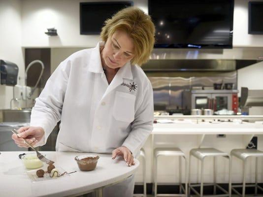 Hershey's Chocolate Lab manager Kyle Nagurny drizzles chocolate over truffles during a demonstration on how to make truffles. Michael K. Dakota - Lebanon Daily News