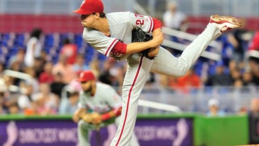 Phillies starting pitcher Aaron Nola (27) throws against the Miami Marlins during the first inning of Sunday's game.