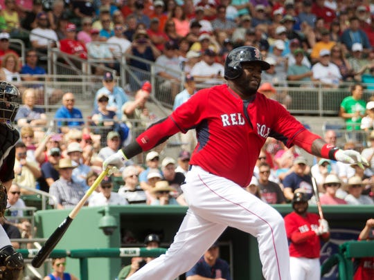 Boston Red Sox DH David Ortiz strikes out against Northeastern University. He is a vocal critic of the new pace of play rules.
