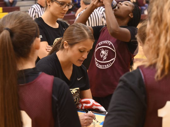Licking Heights girls basketball head coach Rebecca Bailey talks offense with her team after a scrimmage on Tuesday, Nov. 14, 2017