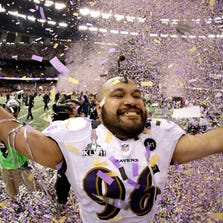 Ma'ake Kemoeatu #96 of the Baltimore Ravens celebrates after the Ravens won 34-31 against the San Francisco 49ers during Super Bowl XLVII at the Mercedes-Benz Superdome on February 3, 2013 in New Orleans, Louisiana.  (