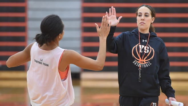 Jess Barley, the head coach of the York Suburban girls basketball team, high fives player Briaunna Banks as she run sprints during practice on Saturday, Dec. 3, 2016.
