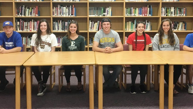 Among the South Lyon and South Lyon East athletes moving on to the college ranks include (from left) Mike Martinez, Ethan Whitcomb, Megn Gesler, Olivia Hewitt, Dawson Moll, Samantha Swain, Savannah Kuhowski and Josh Chezick.