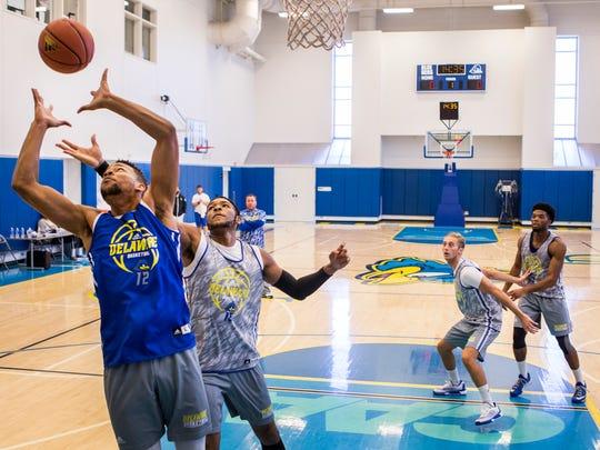 Forward Chivarsky Corbett (No. 12) leaps for a rebound as forward Maurice Jeffers defends during practice for the University of Delaware men's basketball team at the Bob Carpenter Center on Monday afternoon.