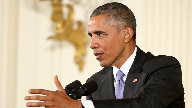 President Barack Obama answers a question during a news conference on July 15th, 2015, in the East Room of the White House in Washington.
