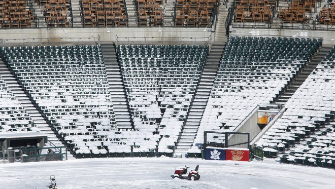 Snow covers home plate at Comerica Park in Detroit last week. With opening day less than two weeks away, this frigid, snowy winter is showing no signs of subsiding.