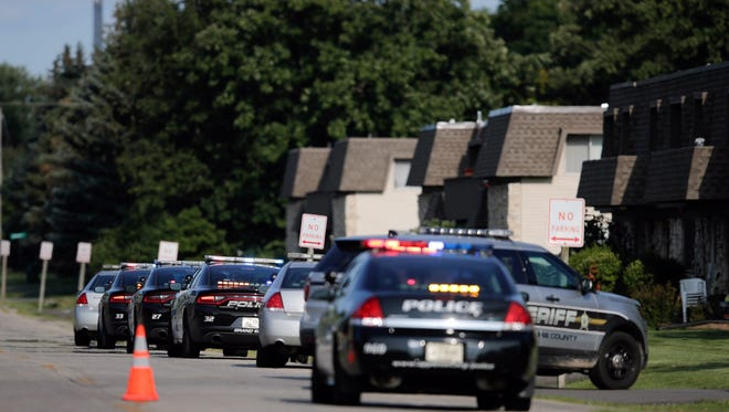 Police vehicles line the 3000 block of W. Fourth Street in Grand Chute on Thursday afternoon.