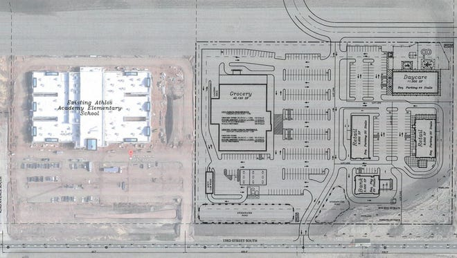 A proposal shows plans for a grocery store with car wash and fuel pumps, a day care, two retail buildings and a bank at the corner of 33rd Street South and Steans County Road 136.