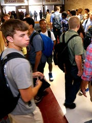Riverdale students crowd the hallway as classes change for fifth period on the first full day of school Monday, Aug. 8, 2016.