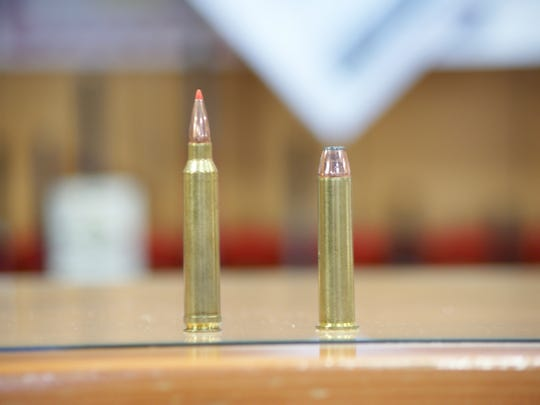 A person can tell the difference between a high-powered rifle round and a straight-walled cartridge by looking at the design of the bullet. High-powered rifle rounds, such as a .300 Win Mag, left, have a bottle-neck shape. Straight-walled cartridges, such as the .45-70, right, are not.