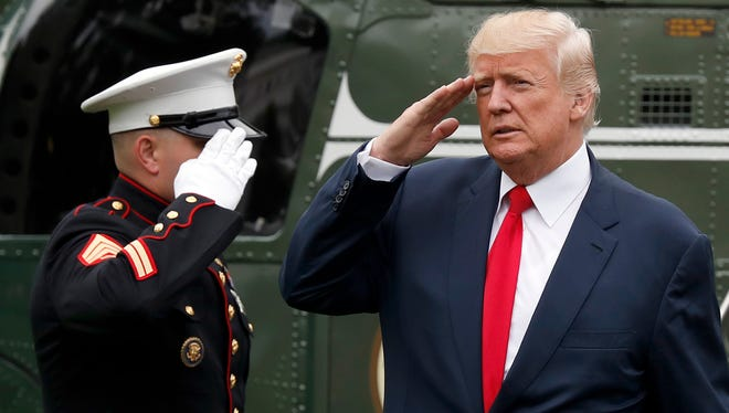 President Donald Trump salutes as he steps off Marine One on the South Lawn of the White House in Washington, Monday, Aug. 14, 2017. Trump is returning from a vacation to Bedminster, N.J.