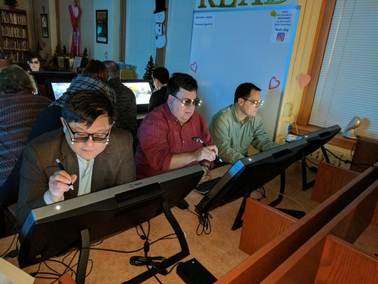 Rutherford Board of Education members from left, Keith Chu, Greg Rancine and Dennis Mazone experimented with Union School's new zSpace, which allows students to interactively learn through 3-D modeling.