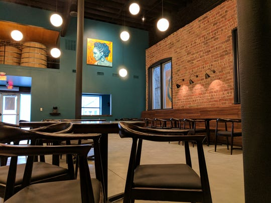 A large, open space houses The Owner's Wife, opening Feb. 26, 2017, near Mass Ave. This family-friendly dining room is flanked by bar areas. The complex also includes a beer garden.
