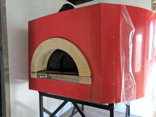 A wood-fired pizza oven was installed at Lupo, an Italian