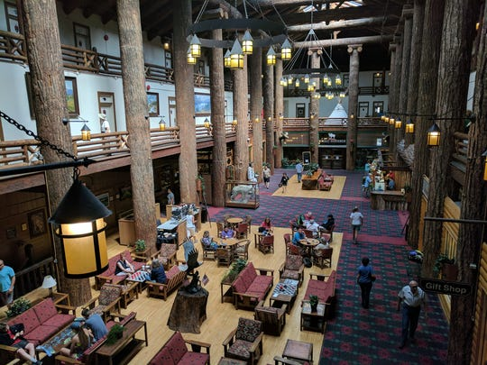 "East Glacier Lodge's cavernous reception area features bark-covered trees harvested 100 years ago.  The lodge is adjacent to a train station, the most common way of getting to the park in the early 20th century. Amtrak's ""Empire Builder"" train still provides service to this hotel at Glacier National Park."