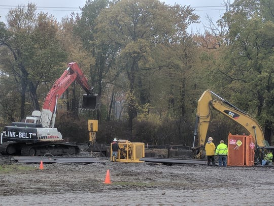 Work crews continue excavation as part of a revamping of Lake Okonoka on the eastern side of Belle Isle on Thursday, Nov. 2, 2017.