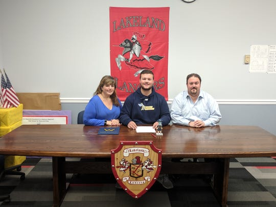Lakeland senior lacrosse standout Anthony Scafuro, center, committed to Wilkes University this week with his family and school administrators by his side.