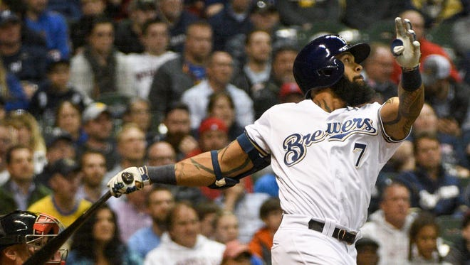 Brewers first baseman Eric Thames watches his RBI double in the fifth inning.