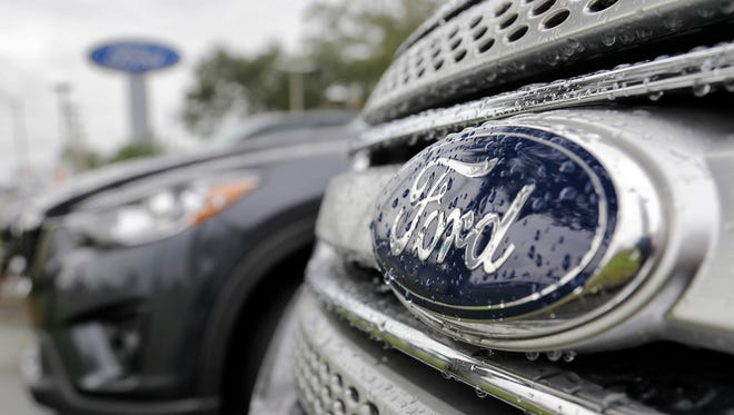 In this Jan. 12, 2015, photo, Ford vehicles sit on the lot at a car dealership, in Brandon, Florida.