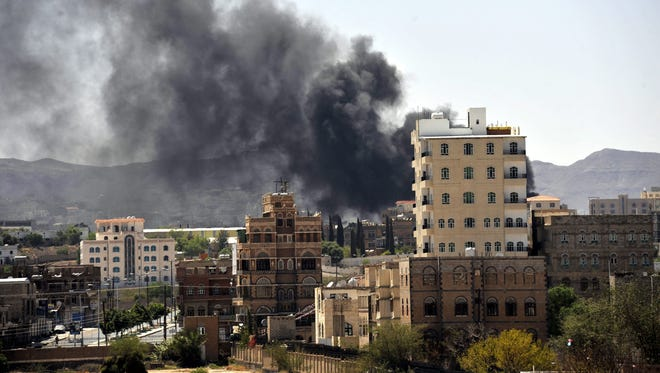 Smokes rise from a neighborhood near the Yemeni state TV headquarters during clashes between Yemeni army troops and Shiite Houthi fighters in Sana'a on Sunday.