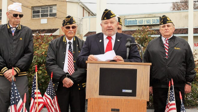 Bound Brook Mayor and Lt. Col. Robert Fazen, U.S. Army Retired, speaks at the American Legion Giles-Biondi Post 63 Bound Brook Annual Veterans Day Ceremony at the War Memorial on Vosseller and Union avenues in Bound Brook on Nov. 11, 2015. The ceremony honored veterans of all wars. Behind Fazen are (from left) Al Wilson, Tom Bernotas, Hal Dietrich (post commander) and Walter Boszczuk.