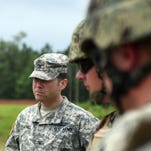 Col. Gregory Michel stands with troops as they prepare to at Camp Shelby Joint Forces Training Center. Michel assumed command of the base in April.