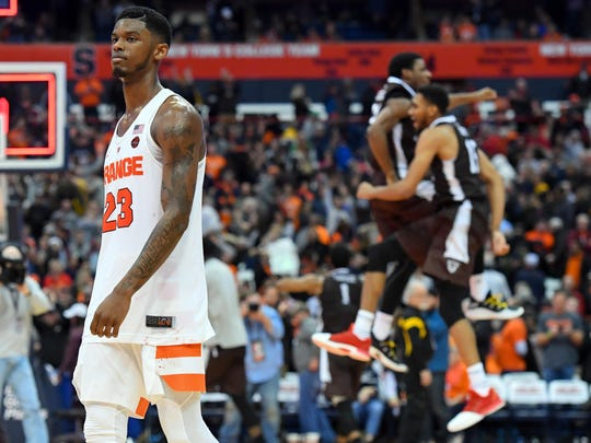 Syracuse Orange guard Frank Howard (23) reacts while