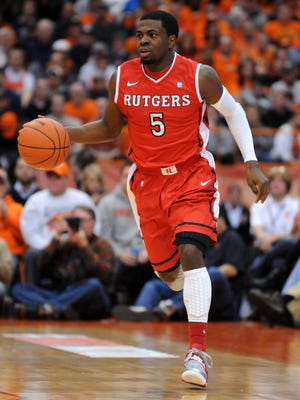 Former Rutgers Scarlet Knights guard Eli Carter (5) brings the ball up court during the first half of a game against the Syracuse Orange in 2012-13.