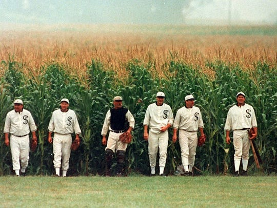 The ghost players emerge from the Field of Dreams for a ballgame at the Don Lansing farm  in 1996.