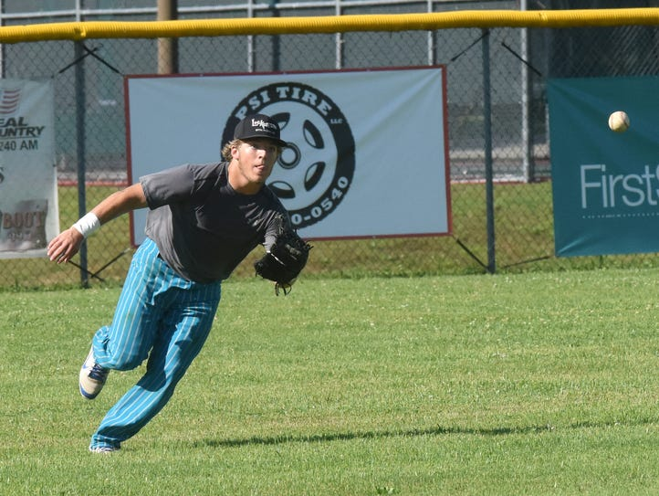 Lockeroom's Caleb Johnson fields a ball in the outfield