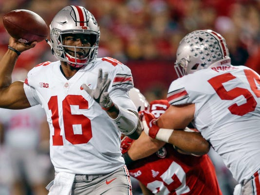 FILE - In this Oct. 14, 2017, file photo, Ohio State quarterback J.T. Barrett (16) throws as offensive lineman Billy Price (54) blocks Nebraska defensive lineman Deontre Thomas (97) during the first half of an NCAA college football game in Lincoln, Neb. Coach Urban Meyer says he likes the progress of the Buckeyes' offense in the past month. He says quarterback J.T. Barrett and the passing game is clicking with Penn State and other tougher games looming after the bye week. (AP Photo/Nati Harnik, File)