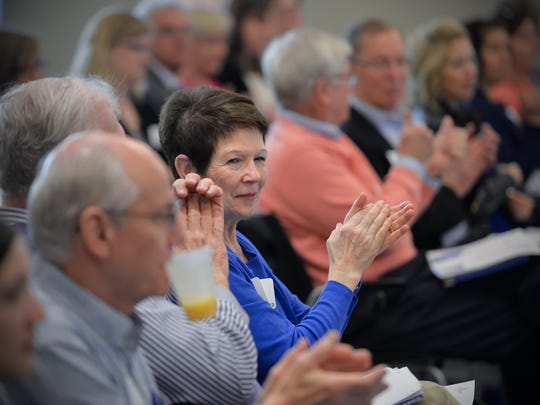 Pat Welter, left center, and other audience members clap after Sauk Rapids-Rice Superintendent Dan Bittman speaks Thursday, May 5, during an education and literacy event sponsored by United Way of Central MInnesota at the new Coborn's corporate offices in St. Cloud.