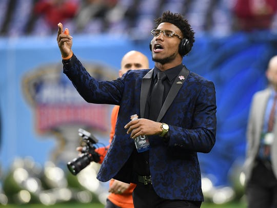 Clemson quarterback Kelly Bryant sings as he walks
