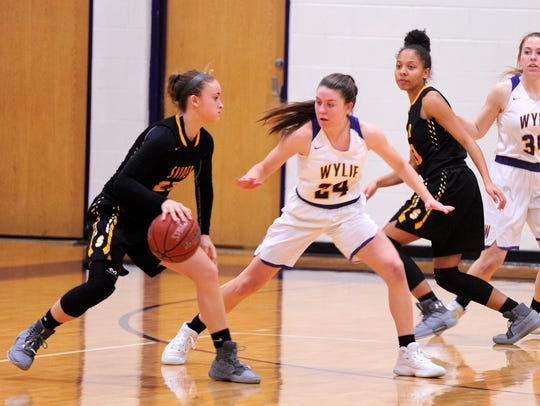 Wylie's Mary Lovelace defends Snyder's Natalee James during the Lady Bulldogs' 76-44 win against Snyder on Jan. 12 at Bulldog Gym.