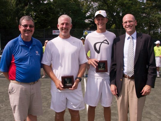 (Left to right:) Tournament referee Barry Fittes, winners Peter and Tanner Smith, and tournament director John Williams