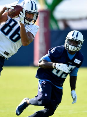 Titans wide receiver Andrew Turzilli (86) pulls in a pass over defensive back Jemea Thomas (35) during practice at St. Thomas Sports Park Friday Aug. 21, 2015, in Nashville, Tenn.