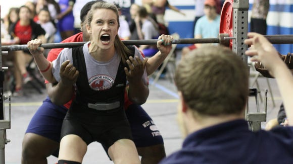 West Monroe's Chelsea Ware squats 190 pounds during the LHSAA State Powerlifting Championships Saturday, Mar. 22, 2014.