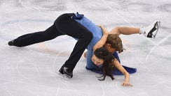 Madison Chock and Evan Bates (USA) fall to the ice
