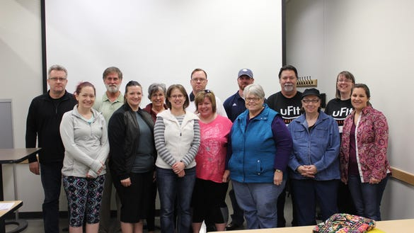 Participants of the 2016 uFit Challenge are pictured in the front row, from left: Stephanie Bracelin, Jayme Mau, Kelsey Gillespie, Jessica Riedell, Betty Litton, Nancy Brown and Erica Ries. Back row: Steve Dickinson, Chuck Ward, Bobbi Liker, Jeremy Riedell, Vince Ries, Jim Young and Kristi Bales. Linda Wilker is not pictured.