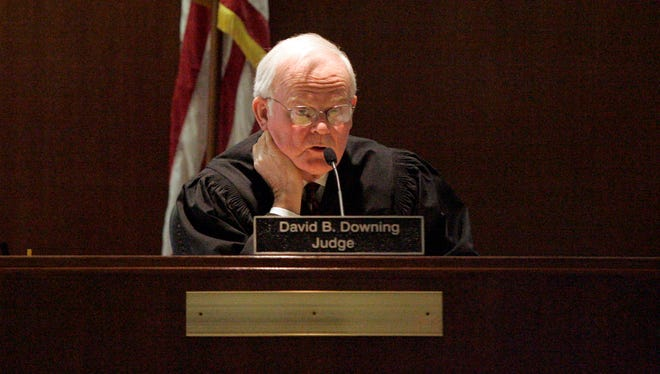 Judge David B. Downing, seen here in 2011, allegedly said he did not touch motions from Kaushal Niroula, an HIV positive murder defendant.