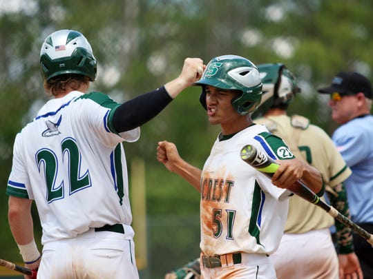 Josue Rivera, right, and Matthew Hurley celebrate their five-run rally during the fourth inning of the 2A regional final against Keswick Christian at Seacrest Country Day School on Wednesday, May 17, 2017. With the win, the Stingrays advance to the state semifinal against Deltona-Trinity Christian at Hammond Stadium on May 24.