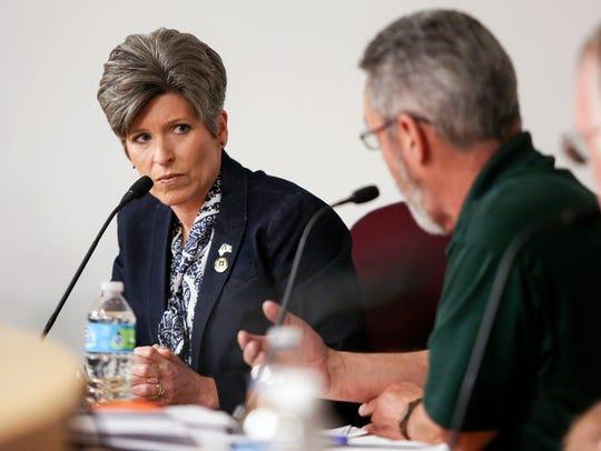U.S. Sen. Joni Ernst, R-Ia., left, listens to concerns