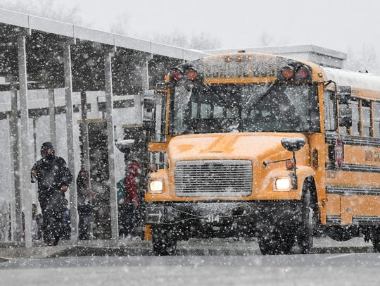 Walhalla High School get on the bus as school ended